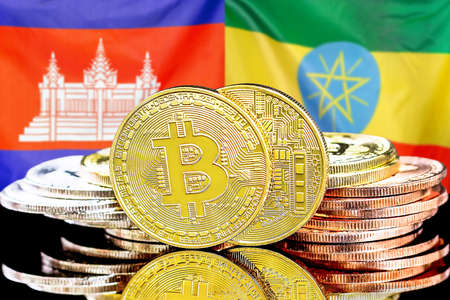 Concept for investors in cryptocurrency and Blockchain technology in the Cambodia and Ethiopia. Bitcoins on the background of the flag Cambodia and Ethiopia.