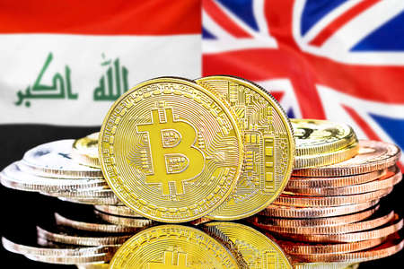 Concept for investors in cryptocurrency and Blockchain technology in the Iraq and United Kingdom. Bitcoins on the background of the flag Iraq and United Kingdom. Foto de archivo