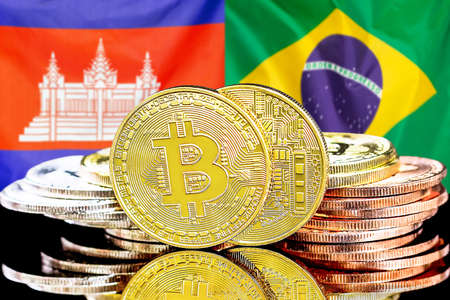 Concept for investors in cryptocurrency and Blockchain technology in the Cambodia and Brazil. Bitcoins on the background of the flag Cambodia and Brazil. Foto de archivo