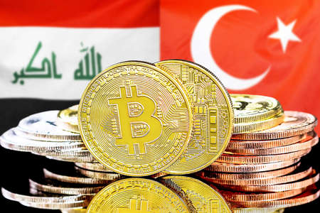 Concept for investors in cryptocurrency and Blockchain technology in the Iraq and Turkey. Bitcoins on the background of the flag Iraq and Turkey.