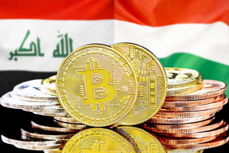 Concept for investors in cryptocurrency and Blockchain technology in the Iraq and Hungary. Bitcoins on the background of the flag Iraq and Hungary. Foto de archivo