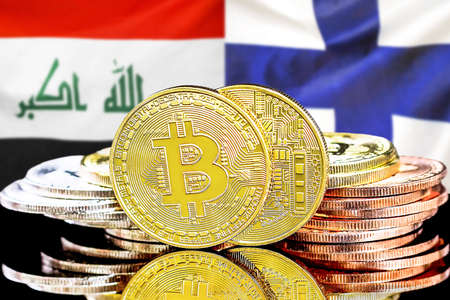 Concept for investors in cryptocurrency and Blockchain technology in the Iraq and Finland. Bitcoins on the background of the flag Iraq and Finland. Foto de archivo