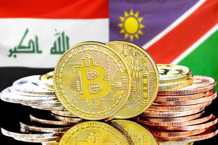 Concept for investors in cryptocurrency and Blockchain technology in the Iraq and Namibia. Bitcoins on the background of the flag Iraq and Namibia. Foto de archivo