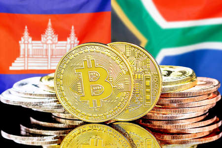 Concept for investors in cryptocurrency and Blockchain technology in the Cambodia and South Africa. Bitcoins on the background of the flag Cambodia and South Africa. Foto de archivo