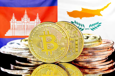 Concept for investors in cryptocurrency and Blockchain technology in the Cambodia and Cyprus. Bitcoins on the background of the flag Cambodia and Cyprus.