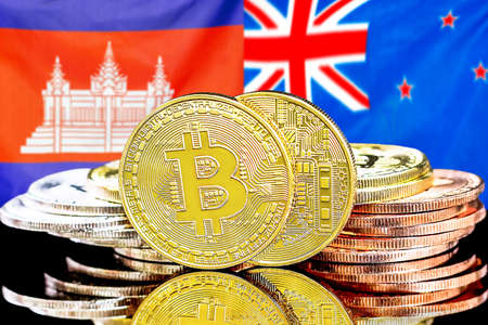 Concept for investors in cryptocurrency and Blockchain technology in the Cambodia and New Zealand. Bitcoins on the background of the flag Cambodia and New Zealand. Foto de archivo
