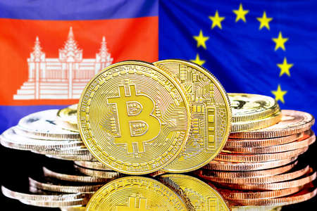 Concept for investors in cryptocurrency and Blockchain technology in the Cambodia and European Union. Bitcoins on the background of the flag Cambodia and EU. Foto de archivo