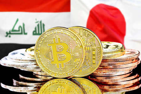 Concept for investors in cryptocurrency and Blockchain technology in the Iraq and Japan. Bitcoins on the background of the flag Iraq and Japan. Foto de archivo