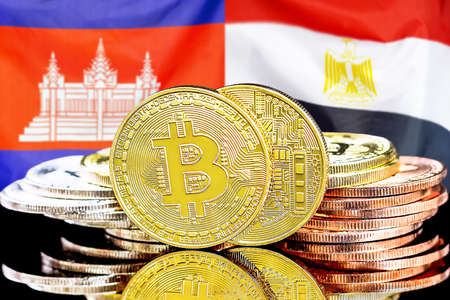 Concept for investors in cryptocurrency and Blockchain technology in the Cambodia and Egypt. Bitcoins on the background of the flag Cambodia and Egypt. Foto de archivo