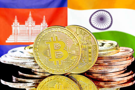 Concept for investors in cryptocurrency and Blockchain technology in the Cambodia and India. Bitcoins on the background of the flag Cambodia and India.