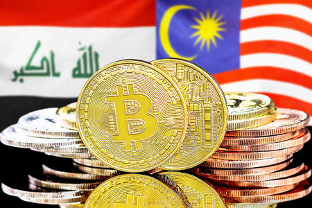 Concept for investors in cryptocurrency and Blockchain technology in the Iraq and Malaysia. Bitcoins on the background of the flag Iraq and Malaysia. Stock Photo
