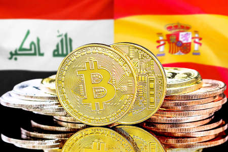 Concept for investors in cryptocurrency and Blockchain technology in the Iraq and Spain. Bitcoins on the background of the flag Iraq and Spain. Stock Photo