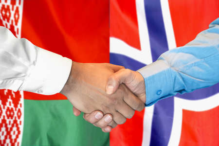Business handshake on the background of two flags. Men handshake on the background of the Belarus and Norway flag. Support concept.