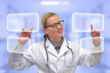 Female doctor with empty virtual displays. Doctor and futuristic concept of medical interface. Mockup. Stock Photo
