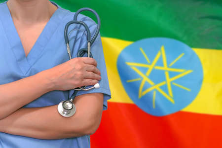 Female surgeon or doctor with stethoscope in hand on the background of the Ethiopia flag. Surgery concept in Ethiopia Reklamní fotografie