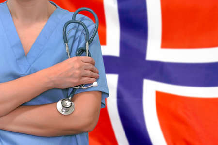 Female surgeon or doctor with stethoscope in hand on the background of the Norway flag. Surgery concept in Norway Stock Photo