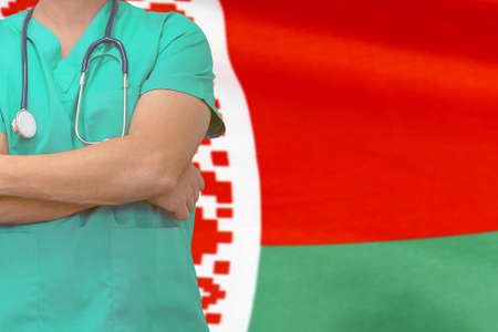 Male surgeon or doctor with stethoscope on the background of the Belarus flag. Health care and medical concept. Surgery concept in Hong Belarus Stock Photo