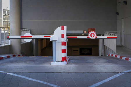 Barrier at Entrance and exit of a car Parking garage. barrier in a car park. Exit from underground parking. Underground parking, garage. Interior of parking