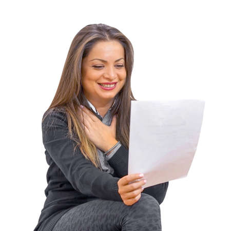 Woman enjoying good news in writing. Woman is happy after reading good news in a written letter, approving a loan.
