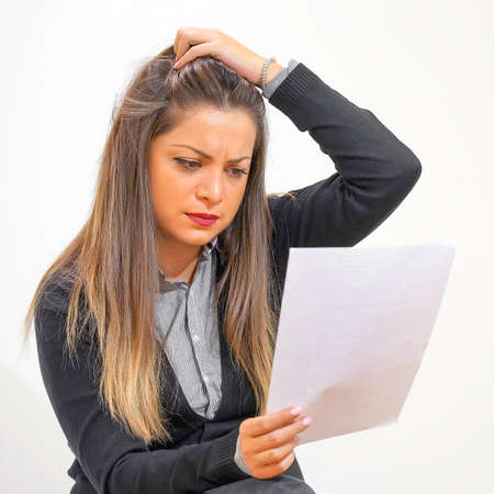 Woman in stress reading paper document or postal letter. Received bank account balance or bad notice