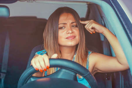 Portrait female displeased angry pissed off aggressive woman driving car. Emotional intelligence concept 免版税图像