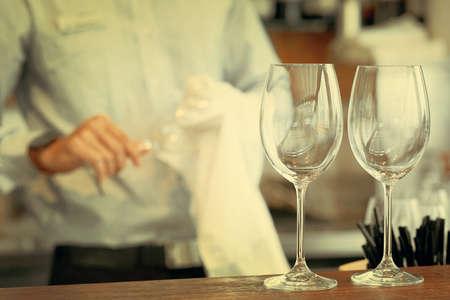 Bartender wipes the wine glasses