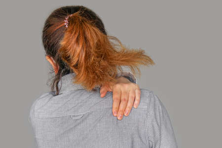 Woman having pain back neck. Attractive Businesswoman Suffer From Neck Pain Reklamní fotografie