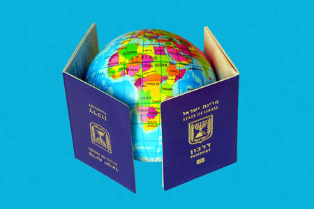 Blue Israeli biometric and non biometric passport. A map or globe of planet earth. International travel identification document. The concept of travel