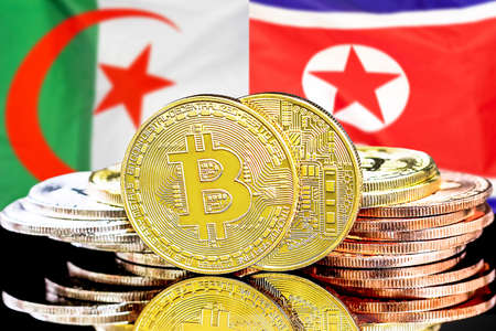 Concept for investors in cryptocurrency and Blockchain technology in the Algeria and North Korea. Bitcoins on the background of the flag Algeria and North Korea