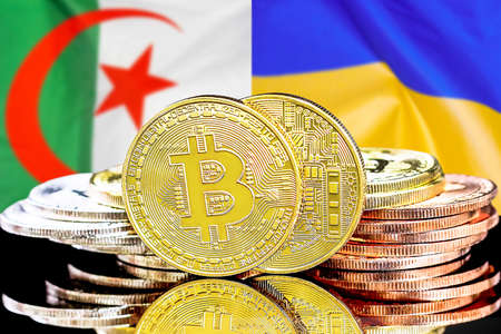 Concept for investors in cryptocurrency and Blockchain technology in the Algeria and Ukraine. Bitcoins on the background of the flag Algeria and Ukraine