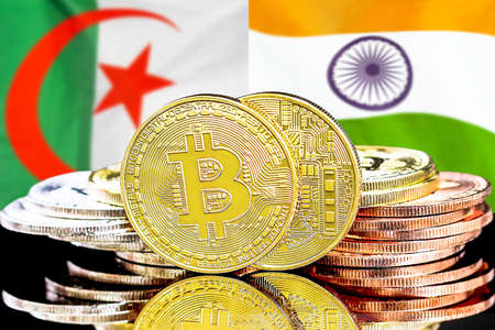 Concept for investors in cryptocurrency and Blockchain technology in the Algeria and India. Bitcoins on the background of the flag Algeria and India Reklamní fotografie