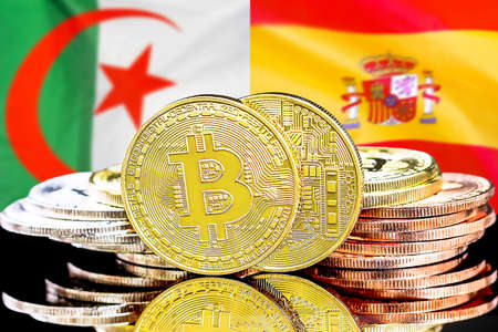 Concept for investors in cryptocurrency and Blockchain technology in the Algeria and Spain. Bitcoins on the background of the flag Algeria and Spain Reklamní fotografie