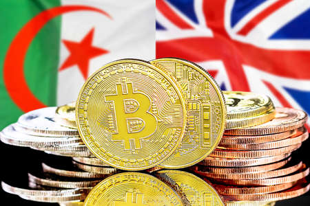 Concept for investors in cryptocurrency and Blockchain technology in the Algeria and United Kingdom. Bitcoins on the background of the flag Algeria and UK