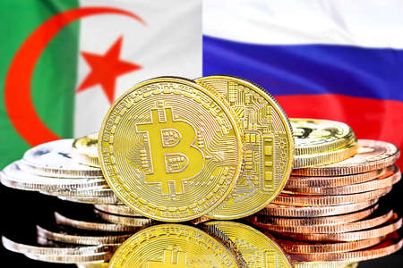 Concept for investors in cryptocurrency and Blockchain technology in the Algeria and Russia. Bitcoins on the background of the flag Algeria and Russia