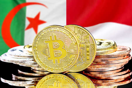 Concept for investors in cryptocurrency and Blockchain technology in the Algeria and Indonesia. Bitcoins on the background of the flag Algeria and Indonesia Reklamní fotografie