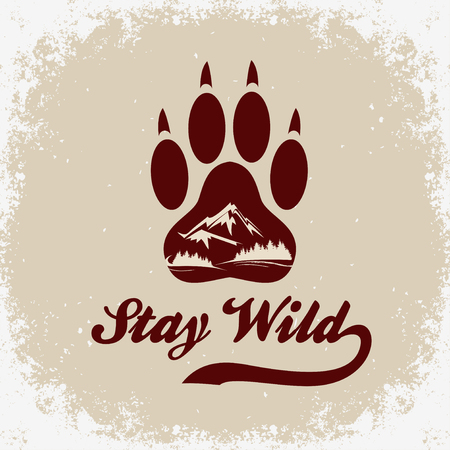 Hand drawn Inspiration Typography for t-shirt print. Stay wild. Travel, adventure poster with paw, mountain and forest.
