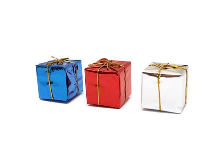 Three boxes with gifts on a white background photo