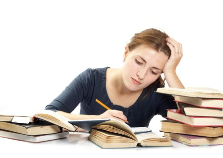 dult: The young woman and a pile of books Stock Photo