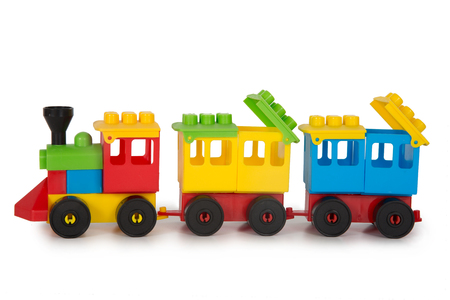 Multicolored plastic toys on a white background