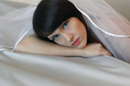 The girl with a veil, a close up  photo