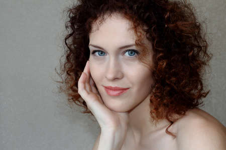 Red and curly girl close up  photo