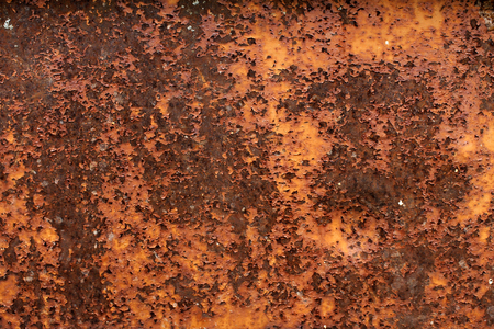 Old metal from rust and old peeling paint the red color. photo