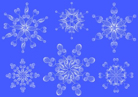 Snowflakes from the curls in the technique of quilling on a blue background.