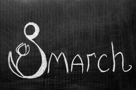 The eighth of March written on the chalkboard . Figure eight with a flower.