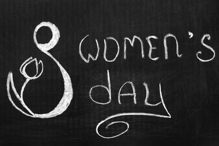 International womens day on eighth March, the inscription on the chalkboard . Фото со стока