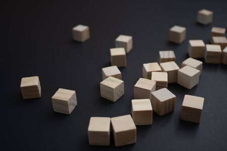 Wooden small blocks on the background. Background for desktop. Office style.Agile and scrum. Team players.Social life.In the office.Equality and diversity