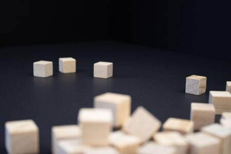 Wooden small blocks on the background. Background for desktop.Office agile style.
