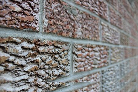 Brown brick wall in perspective.City life,sunny summer,beautiful background. Stockfoto