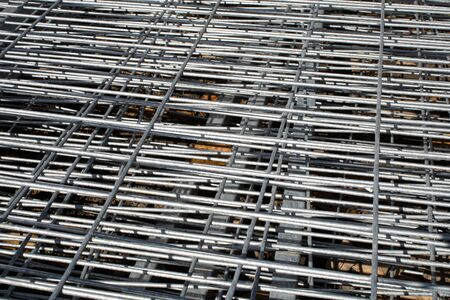 Metal grid industrial background in perspective.Construction art and texture.Metal material.Urban style concept.Outdoor renovation.Building the wall. Stockfoto