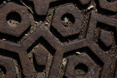 Textured rusted metal on a road and concrete.Industrial background.Abstract style. Stockfoto